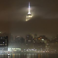 """The @EmpireStateBldg peeking through the fog"""