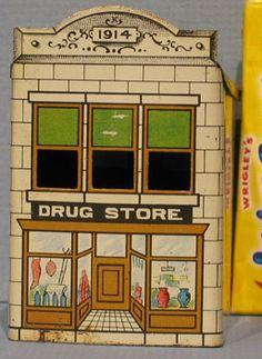 "1914 Tin Candy Container ""Drug Store""....there were a variety of buildings and they had a glass insert that held the candy"
