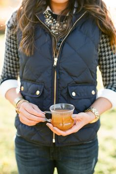 puffer vest, sweater, statement necklace and watch! Maybe not the white button up underneath but this is cute!!