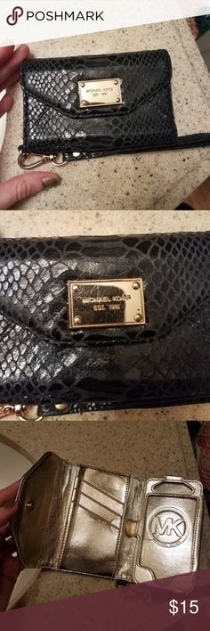 Michael Kors Black Wallet This very used MK Wallet can hold an iphone (not sure which kind) I can take measurements if you just ask. It has a few flaws but still perfectly functional. Offers always welcome. Michael Kors Bags Wallets