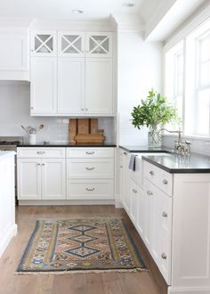 Honed black granite countertops, Benjamin Moore classic gray wall color, simply white cabinetry | Studio McGee