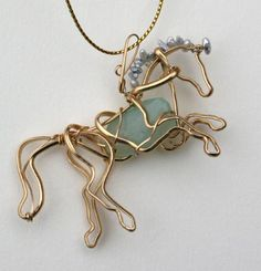 Rearing horse with genuine chalcedony and freshwater pearl mane $175