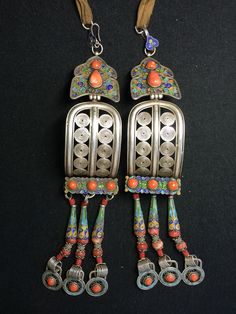 Pair of Uzemchin women's earrings. Enamelled silver, coral, turquoise. Mongolia, 19th/20th c. Private collection