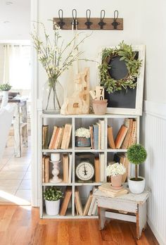 Farmhouse style decor idea for any home. Beautiful vintage cubby styled with old books and antiques!