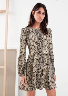 Mini length leopard print dress with subtle puff sleeves and a flowy, duo seam ruffle skirt.Elasticated cuffs Center back zipperLength of dress: / (size wears: EU 36 / UK 10 / US 4 / SmallModel height: / style runs small, for a relaxed fit please size up. Holly Willoughby Outfits, Western Outfits Women, Clothing Blogs, Fashion Story, Women Wear, My Style, How To Wear, Clothes, Mini Dresses