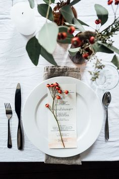 15 Inspirational Ideas For Creating A Modern Christmas Table Full Of Natural Elements // If you have lots of things on the menu for Christmas dinner, including a menu embellished with a small berry branch might be a nice way to let guests know what's coming and makes the table look professionally styled.
