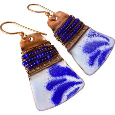 Copper Fold Formed Enamel Earrings  These hand crafted enamel earrings are made from copper sheet that was made by folding a piece of copper sheet and hammering it, then annealing and unfolding it, then repeating that process for each of the folds. A few layers of standard blue counter enamel is applied to the back and several layers of colored enamel is applied to the front. Each layer is torch fired to fuse the glass to the copper. The earrings measure 2 inches with copper ear wires.