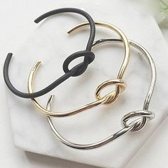 Knotted Bangle Bracelet is available in black, gold and silver tone plated…