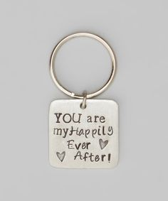 Sweet! Posh pewter crafts this key chain, letting a reminder of love gleam with each turn of the key. Beautifully engraved, its positive message is sure to shine through the ages.0.9'' W x 0.9'' LPewterMade in the USA