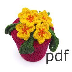 Crochet pattern of primrose flowers in pot by RoseCottageCraftsUK, £2.00