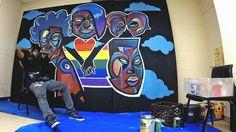 Kalkidan Assefa works on his new mural for transgender people of colour.