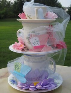 MAD HATTER - Mismatched Stacked TeaCup Centerpiece. This would be so fun for an Alice in Wonderland themed wedding!