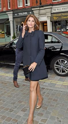 Tres chic: The 28-year-old kept her look simple but oh-so chic as she was pictured making ...
