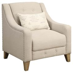Bring stately style to your living room or chair with this linen-upholstered arm chair, showcasing wood legs and nailhead trim.     Pr...