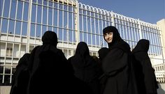 Greek orthodox nuns standing outside a prison in Athens, protesting the arrest of a powerful Greek abbot for corruption.