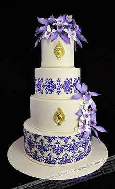White and Purple Cake with Purple Orchids