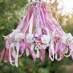 Learn how to make a beautiful chandelier from an old lampshade and some ribbon. This one is different than the rest!