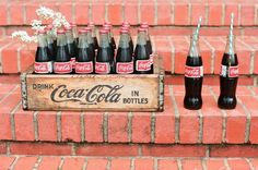 Custom made Coca-Cola chandelier. It is made from a recycled bicycle rim and the small glass Coca-Cola bottles Coca Cola Bottles, Bar Drinks, Sweet Tea, Southern Belle, Marshmallows, Wedding Signs, Wedding Ideas, Magnolia, Crates