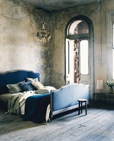 blue linen upholstered bed. Rustic, gorgeous space in grey and beige.