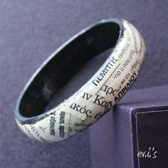 Homemade bracelet with old newspaper