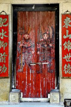 Door gods on the front gate of a traditional Chinese residence in Guangdong province.