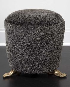 KELLY WEARSTLER | FOOT STOOL. Handmade from luxurious shearling mounted atop solid brass cast feet.