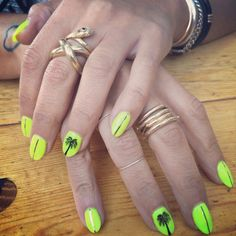 Neon yellow with gold tape line and hand painted Palm trees. Cal gel extension and art done at Marie Nails Melrose Los Angeles ca.