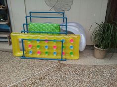 DIY PVC pool side storage for pool floats and toys. Pvc Pool, Pool Decks, Pool Fun, Pool Float Storage, Pool Toy Storage, Kayak Storage, Pool Organization, Pool Signs, Pool Furniture