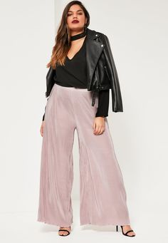 Be on fleek with your outfit in these nude plated pants with wide leg and fluted hem.