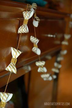 Baby shower decor tutorials: gold washi tape onesie + bowtie garlands  {Handcrafted Parties}