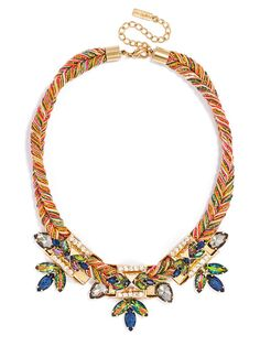 This mixed-media statement features a colorful cord crafted from embroidery thread and rope, edged up by fierce gold accents, gemstones or beaded fringe.