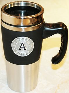 Coffee stays warm in our Varsity Travel Mug! Available for $24.