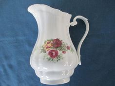 Vintage Porcelain Floral Water Pitcher With Gold Trim by BitofHope