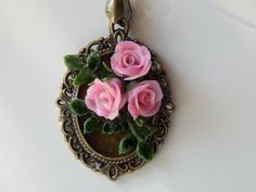Pink Roses on bronze colored setting.