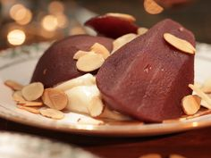 Mulled Wine Poached Pears with Toasted Almonds Recipe : Damaris Phillips : Food Network Almond Recipes, Fruit Recipes, Baking Recipes, Dessert Recipes, Yummy Recipes, Snack Recipes, Healthy Recipes, Snacks, Southern At Heart Recipes