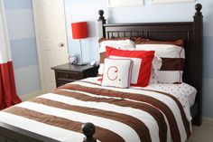 Classic Nautical, I designed this nautical themed room for my soon-to-be 3 year old! We went with a classic color scheme of red, white, blue and brown with accents of nautical. Paint is by Sherwin Williams: icelandic blue, blissfull blue. bedding by serena and lily. furniture: Stanley Young America. drapes: custom made, Boys' Rooms Design