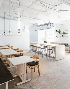 68 Claremont by Tom Chung Studio - Local firm Tom Chung Studio has converted an industrial space in downtown Toronto into a multi-purpose venue with rooms and furniture that can be easily reconfigured. The project, titled 68 Claremont, entailed the conversion of the third floor inside an old brick factory into Free Space – an office and events facility. The architect used a restrained materials palette that includes raw pine, Douglas fir plywood and galvanised steel.