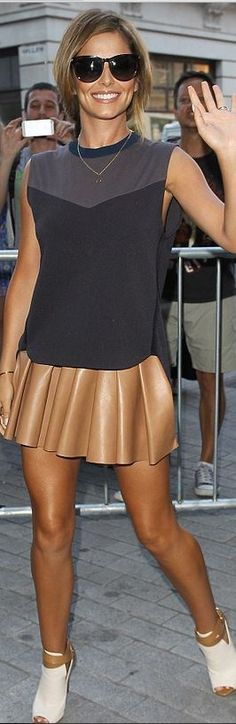 Cheryl Cole, black sweetheart top and brown pleated leather skirt
