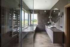 The elegant and classic features of this modern home designed by Interdio are decided in light and monochrome color palette and evoke calm and serene atmosphere Roman Curtains, Bathtub, Bathrooms, Home, Holiday Decorating, Nail Bling, Wedding Decoration, Christmas Decor, Bedroom Decor