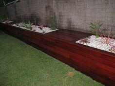 a 12mtr long hardwood planter deck seat  www.cpricelandscapes.com Planter Box Designs, Planter Boxes, Planters, Garden Landscaping, Hardwood, Exterior, Landscape, Patio Ideas, Deck