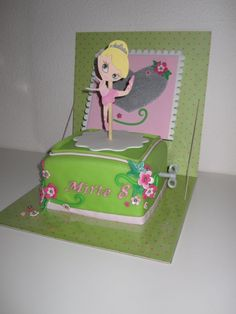 Cute little music box cake with a ballerina on top.