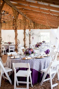 White and purple patterned tablecloth over a solid purple softens the look of this tablescape
