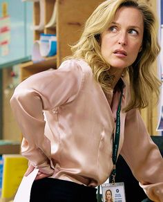 Gillian Anderson as Stella Gibson in The Fall     Her silk blouses are on point.