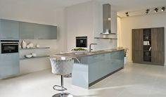 Light blue high gloss kitchen design with kitchen island.