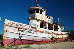 A boat deposited on the inland side of Highway 90 by Hurricane Camille in August of 1969 serves as Gulfport's memorial to that hurricane. The damage and rust were caused by Hurricane Katrina in 2005.