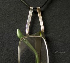 Simple necklace made from vintage silver plated silverware, circa 1940s. - wear this beautiful pendant alone - add a bead to the necklace - use the pendant as a ring holder, never loose your rings again - use the pendant as an eye glasses holder, never misplace your eye glasses again - use as