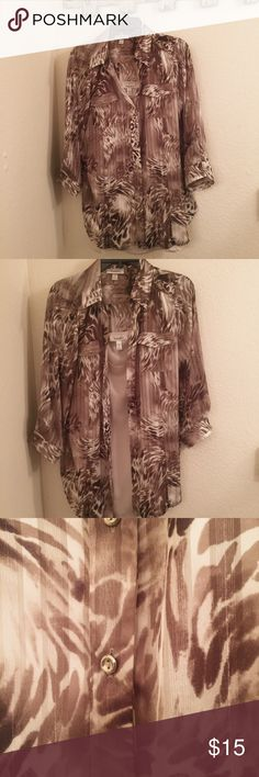 Button down sheer blouse with attached tank top Animal print sheer fabric with metallic vertical lines imprinted on the material. 3/4 sleeves. Silver buttons, collared shirt with attached cream colored tank top underneath. NWOT Dress Barn Tops Button Down Shirts