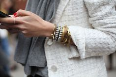 White Tweed Blazer plus bracelets.