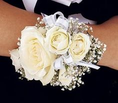 Wrist Corsage with white roses, baby's breath and ribbon accent Prom Corsage And Boutonniere, Bridesmaid Corsage, Corsage Wedding, Wedding Bouquets, Boutonnieres, White Corsage, Flower Corsage, Prom Flowers, White Wedding Flowers