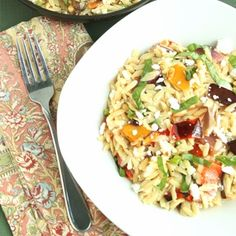 Ina Garten's Orzo with Roasted Vegetables. To make it vega: Substitute vegan cheese.